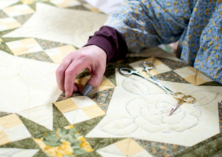 Midsection of woman doing craft on table
