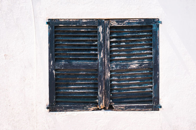 Window Built Structure Architecture Closed Building Exterior Shutter No People Day Building Wood - Material Wall - Building Feature Safety Security Protection Metal House Old Sunlight Outdoors Residential District Window Frame Green Color Whitewall