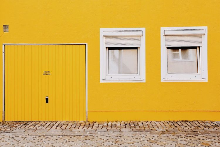 View of windows on yellow wall