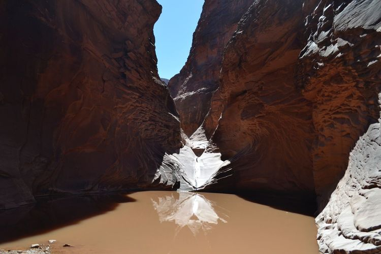 Rock formations of the grand canyon with water reflection