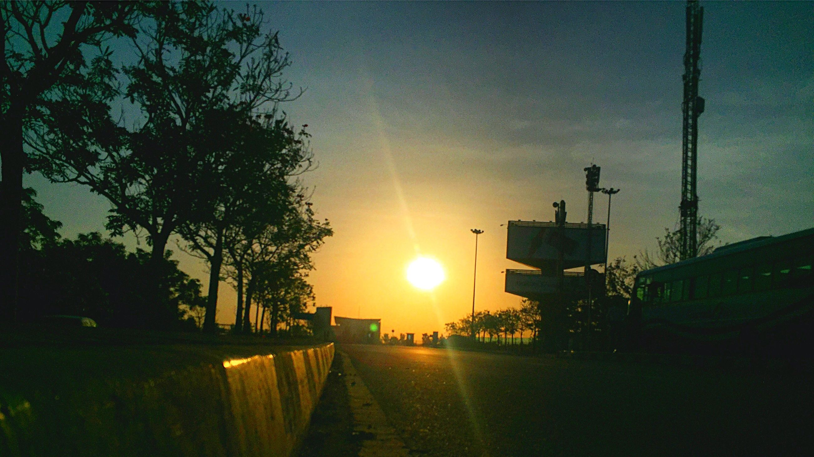 sunset, tree, transportation, mode of transport, sky, sun, outdoors, land vehicle, nature, the way forward, beauty in nature, no people, day