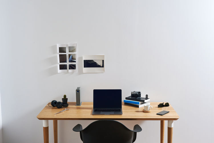 Chair on table against wall