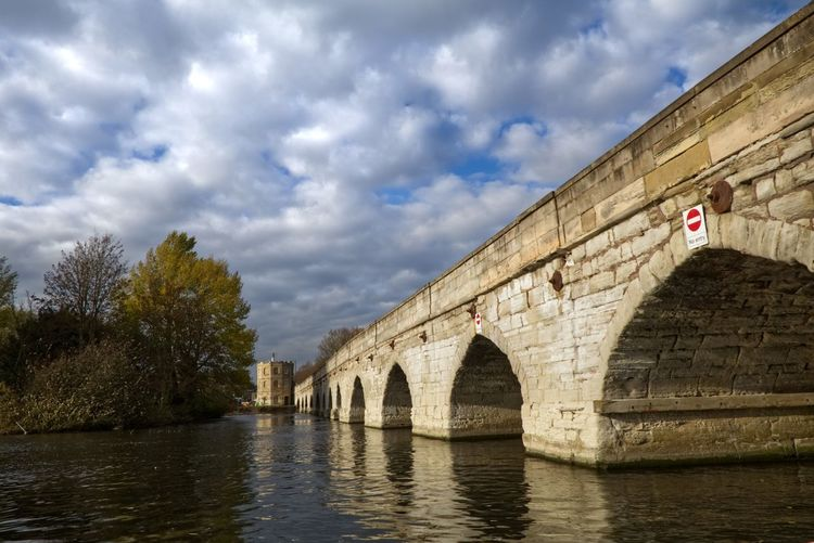 Clopton Bridge at Stratford. Architecture Built Structure Bridge Bridge - Man Made Structure Cloud - Sky Sky Arch Connection Water Nature River Waterfront History The Past Transportation Building Exterior Tree No People Day Arch Bridge Outdoors Arched EyeEmNewHere