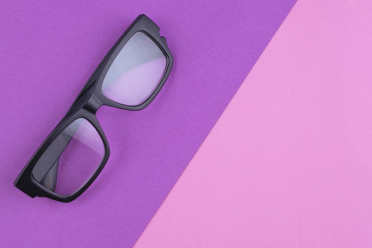 eye glasses spectacles with shiny black frame on pastel color background Glasses Pink Color Eyeglasses  Indoors  No People Single Object Still Life Close-up Eyesight Copy Space High Angle View Purple Personal Accessory Transparent Glass - Material Studio Shot Healthcare And Medicine Colored Background Fashion Vision