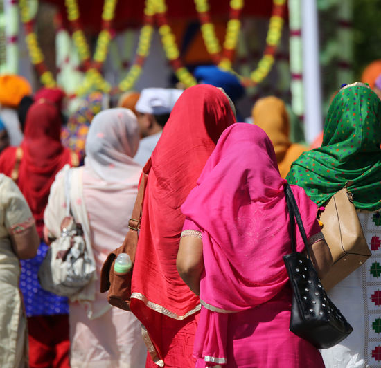 two young sikh women with colored dress in the street during religious festival Celebration City Life Indian Indian Culture  Sikhi Vivid Colours  Woman Clothing Day Daylight Manifestation Outddors Outdoors People Real People Rear View Rite Sikh Sikh People Sikh Religion Sikhism Sikhs Sikkim Veil Women