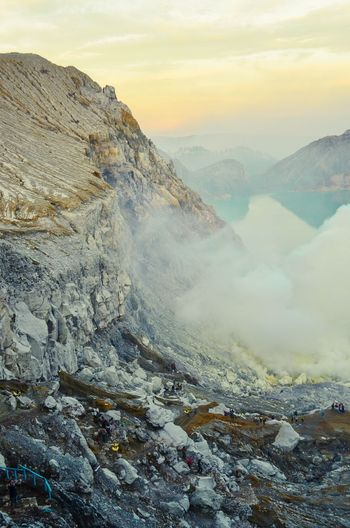 Ijen Crater Ijen Crater Mountain Lake Crater EyeEmNewHere EyeEm Selects EyeEm Best Shots Nikonphotography Nature Photography Landscape Environment Landscape Mountain Scenics - Nature Sky Fog Nature Beauty In Nature Cloud - Sky Morning Sunrise - Dawn Winter Land Sun Snow Architecture Cold Temperature Tranquility Travel Mountain Range