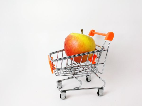 the fruit of the apple in the trolley EyeEm Selects Fruit Consumerism Shopping Cart Apple - Fruit Food And Drink Supermarket Healthy Eating Shopping Basket Food Citrus Fruit Retail  Merchandise Groceries Basket Freshness Indoors  No People Studio Shot White Background Close-up Food Stories