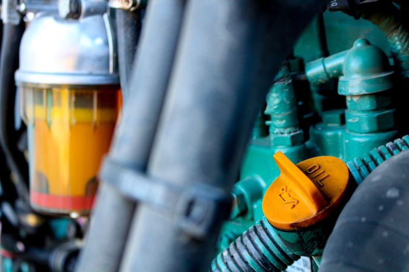 Checking my engine fluids. Close-up Engine Engine Bay Oil Green Orange Excavator At Work Heavy Machinery Canon T5i