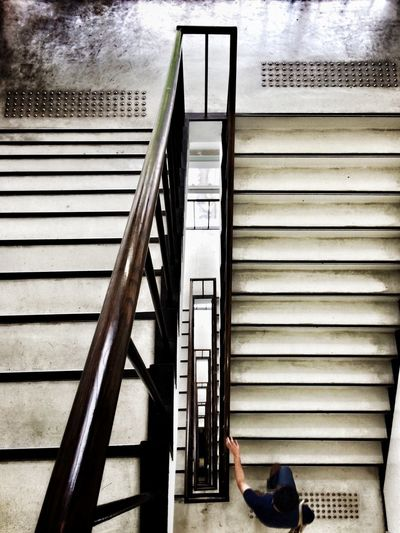 Low section of woman on staircase in building