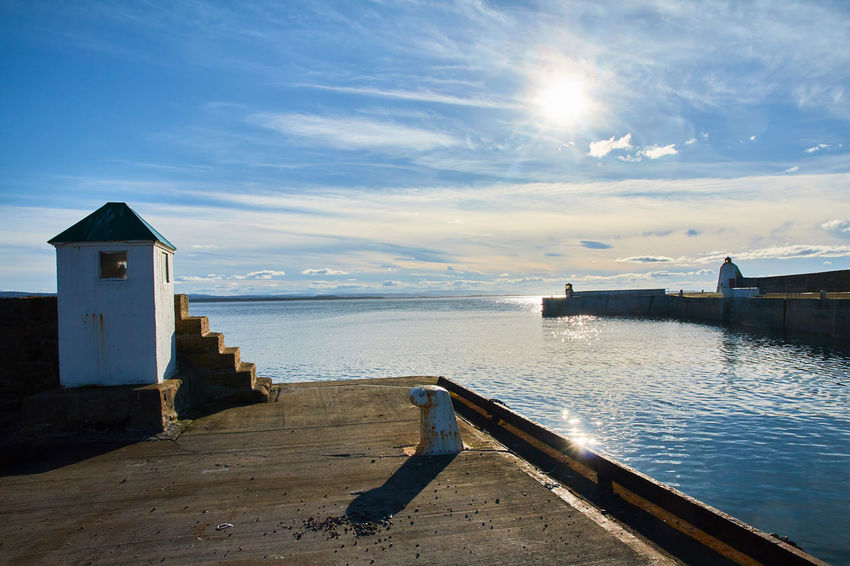 The Harbour entrance in Burghead. Burghead Harbour Pier Reflection Scotland Blue Sky And Clouds Jetty Moray Firth Morayshire Quay Sea