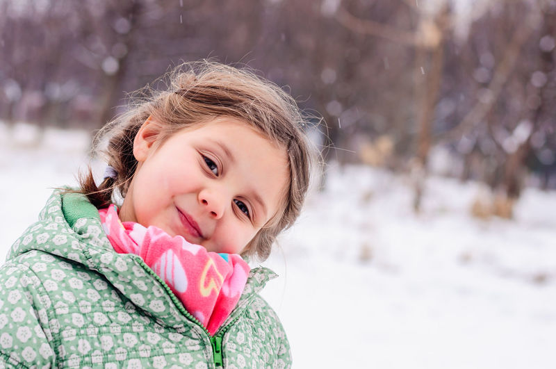 Portrait of smiling girl in snow