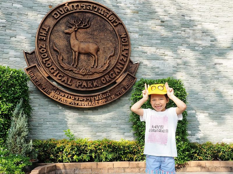 Pretty girl rabbit in front of The Zoological Park Organization Sign. Dusit Zoo Bangkok Zoo Cute Girl, Children Portrait Looking At Camera Sun Hat Smiling Hat