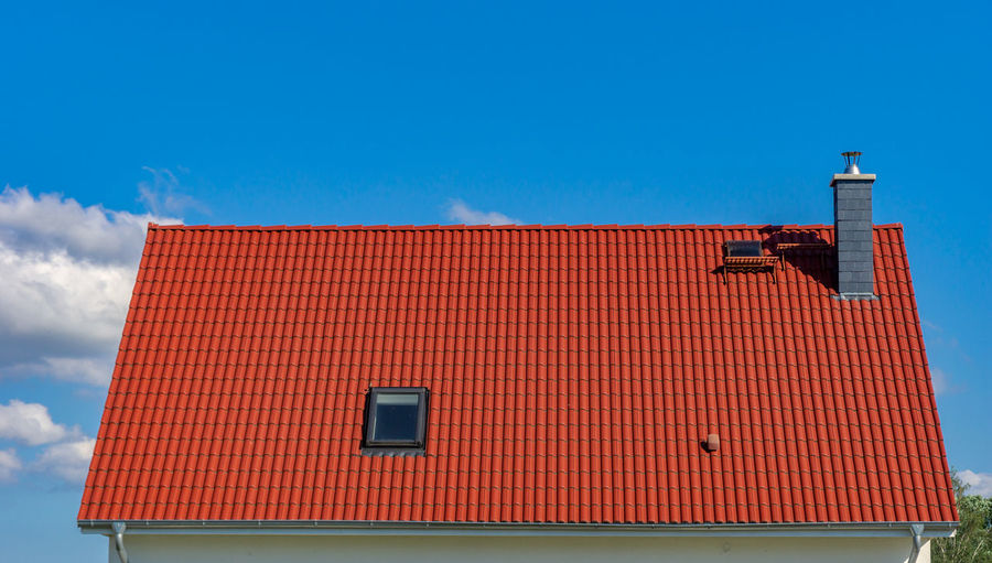 red tiled roof - blue sky Architecture Building Exterior Built Structure Sky No People Low Angle View Nature Building Blue Residential District Day Sunlight Red Cloud - Sky Copy Space Roof House High Section Outdoors Roof Tile Roofer Business Construction Industry