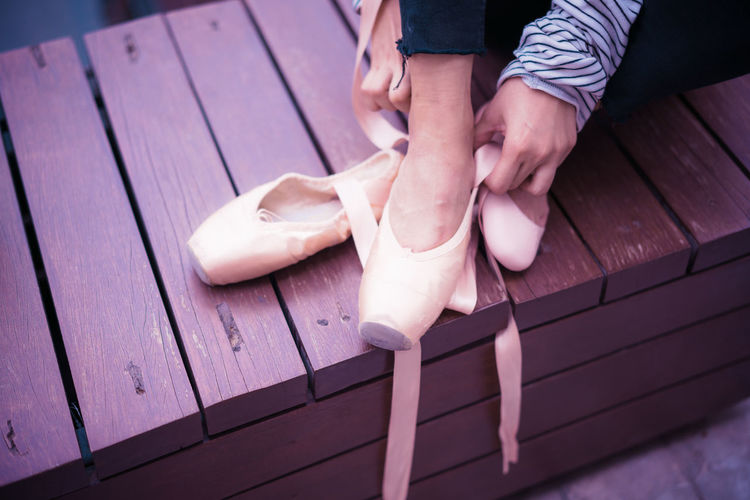 Low Section Of Girl Wearing Ballet Shoe