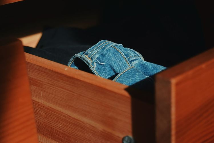 High Angle View Of Jeans In Drawer