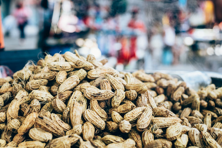 Close-up of peanut pile at market stall