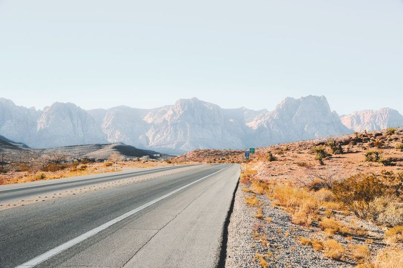 desert vibes Endless Road Nevada Red Rock Canyon EyeEm Selects Mountain Road Mountain Range Transportation Landscape The Way Forward Scenics Day Nature Clear Sky Outdoors Tranquil Scene Tranquility No People Sunlight Arid Climate Beauty In Nature Physical Geography Desert Mountain Road