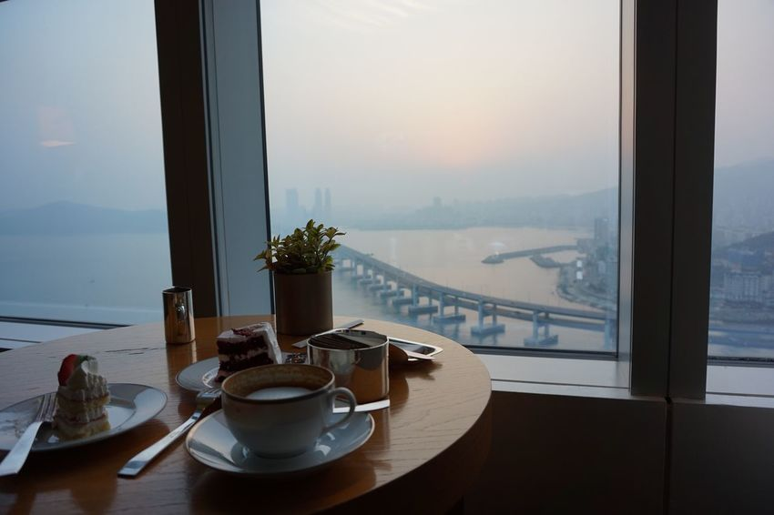 Architecture Structure Bridge High Angle View View Ocean Tea Time Cappuccino Coffee Window Table Indoors  Food And Drink Plate No People Refreshment Drink Nature Sea Water Close-up Sky