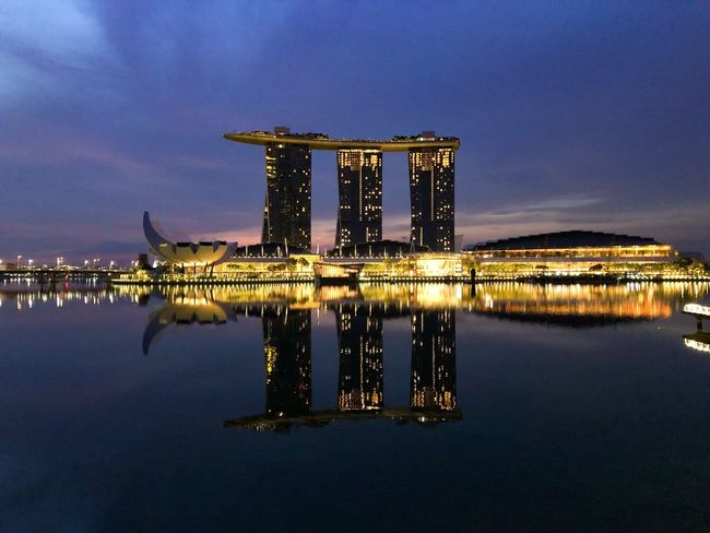 Before Dawn Reflected  Singapore Marina Bay Sands Water Architecture Built Structure Illuminated Reflection Night Building Exterior Sky Waterfront No People Sea City Hotel Outdoors Luxury Office Building Exterior