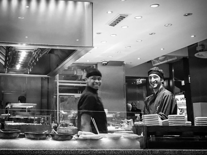 Indoors  Restaurant Business Front View Store Real People Lifestyles Occupation Commercial Kitchen Looking At Camera Young Women Portrait Women Men Food Working Young Adult Chef One Person Day