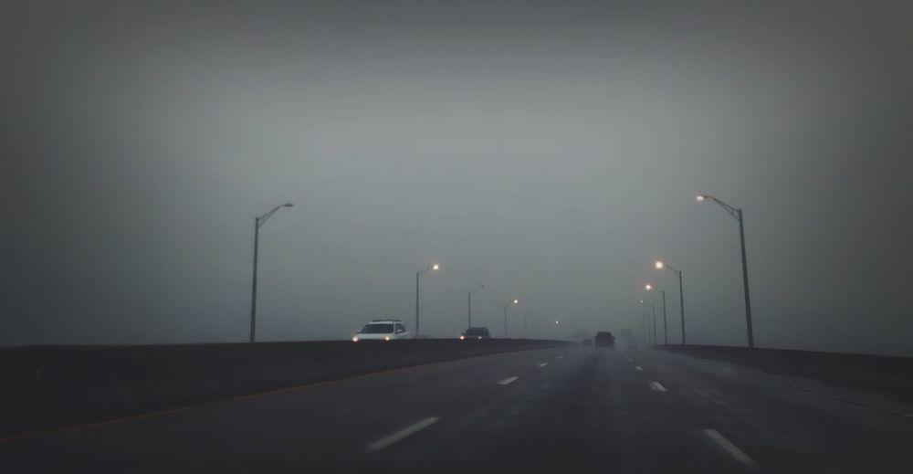 Lighting the way Lights On The Road Road Bridge Rain Rainy Days Streetphotography Streetlights Vanishing Point IPhoneography