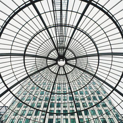 Skyscraper viewed through glass ceiling
