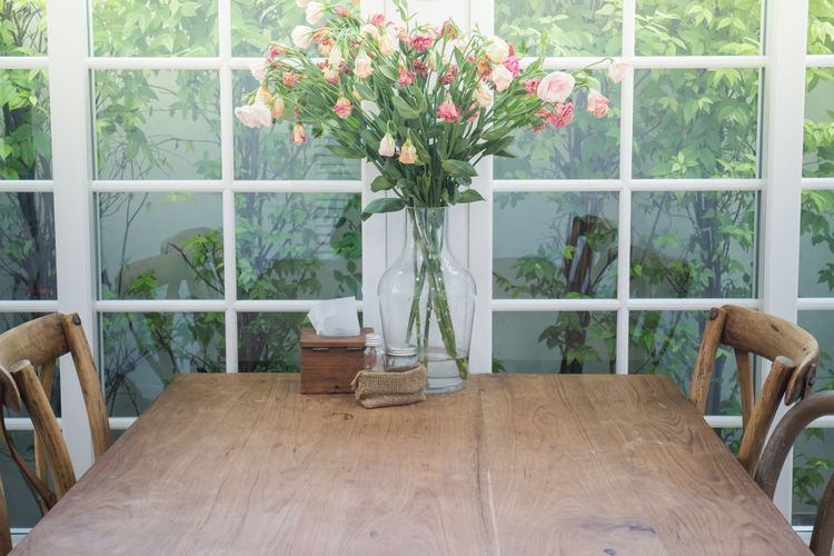 Flower vase on table at home