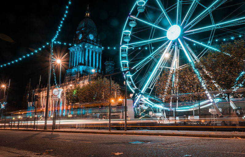 Ferry Wheel Night Architecture Amusement Park Ferris Wheel Amusement Park Ride City Built Structure Building Exterior Street Motion Arts Culture And Entertainment Office Building Exterior Street Light Travel Destinations Transportation Illuminated No People Long Exposure Outdoors Sky Leeds United Kingdom City Uk London Government Citycouncil