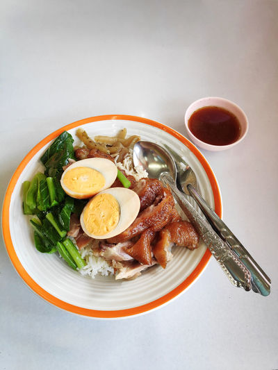 Rice with pork leg. Thai food. Food And Drink Food Healthy Eating Ready-to-eat Indoors  Meat Egg Meal Vegetable Kitchen Utensil Eating Utensil Plate No People Bowl Breakfast Boiled Egg Thai Food Pork Leg Rice