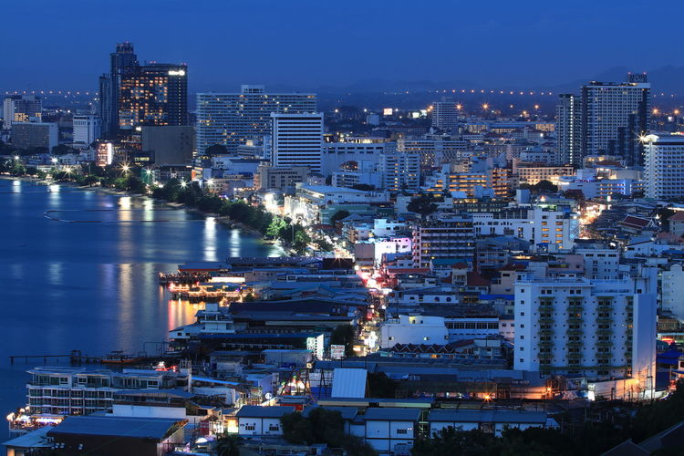 Chonburi ,Thailand Pattaya Thailand Architecture Building Building Exterior Built Structure City City Life Cityscape Evening Financial District  High Angle View Illuminated Nature Night No People Office Building Exterior Outdoors Residential District Sea Settlement Sky Skyscraper Tall - High