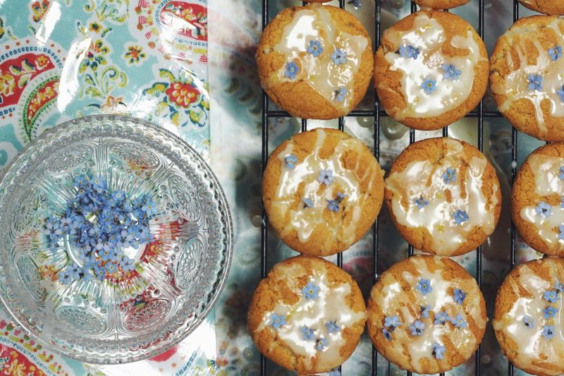 View of cookies on tray next to flowers for decoration