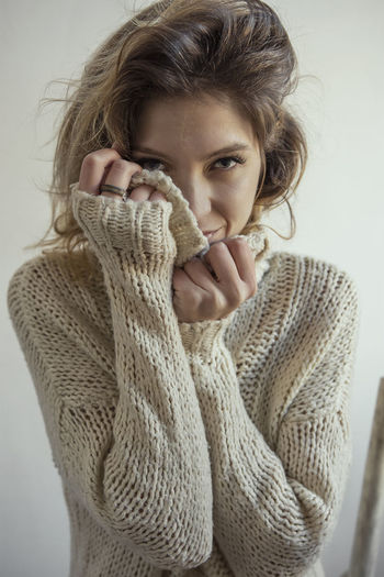 Beautiful woman, beautiful light One Person Portrait Young Adult Sweater Warm Clothing Clothing Winter Looking At Camera Adult Indoors  Women Studio Shot Headshot Beauty Young Women Turtleneck Beautiful Woman Front View Hair Scarf Hairstyle Contemplation International Women's Day 2019
