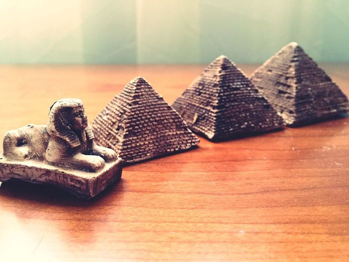 Replica Of The Sphinx And Pyramid On Table At Home