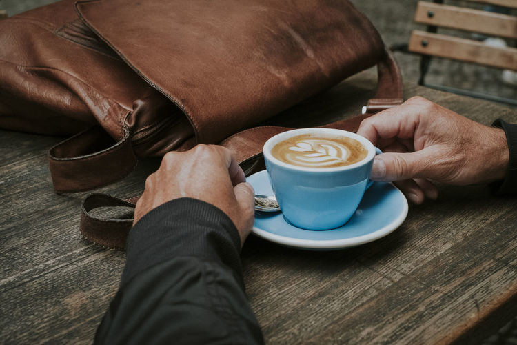Breakfast Coffee Mitte Break Cafe Cappuccino Coffee Coffee - Drink Coffee Break Coffee Cup Drink Holding Hot Drink Latte Art Leather Bag Lifestyles One Man Only One Person Real People Table