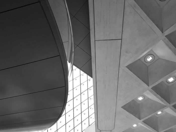 Shapes And Forms Low Angle View Architecture Built Structure Ceiling Concrete Geometric Shape Staircase Glass Lighting Dephts Black And White Monochrome Huaweiphotography Leica Louvre Paris France