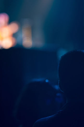 Close-up portrait of silhouette people at music concert