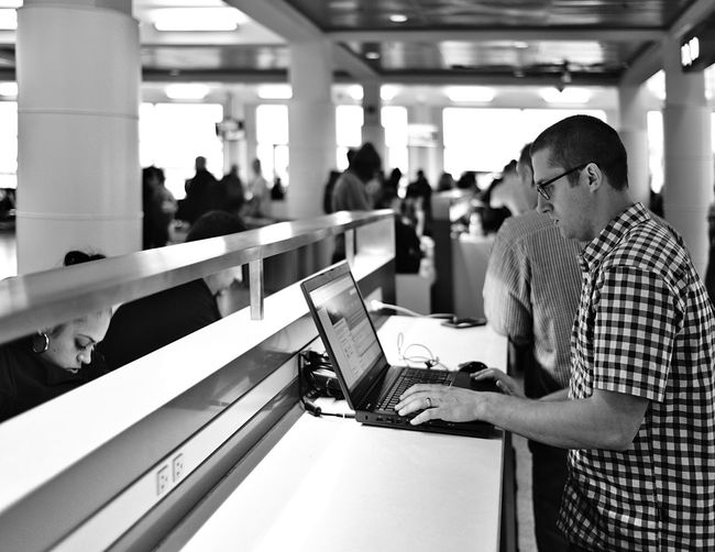 Who needs an office? Adult Adults Only Airport Day Indoors  Laptop Leisure Activity Lifestyles Men One Man Only One Person Only Men People Real People Senior Adult Technology Touch Screen Waiting Waitintg