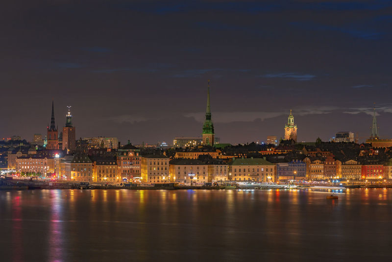 View over Stockholm old town during night Architecture Building Exterior Built Structure Capital Cities  City City Life Cityscape Cloud - Sky Famous Place Gamla Stan Glow In The Dark Illuminated Night No People Old Town Outdoors Residential District Scandinavia Sky Stockholm Sweden Tourism Travel Destinations Water Waterfront