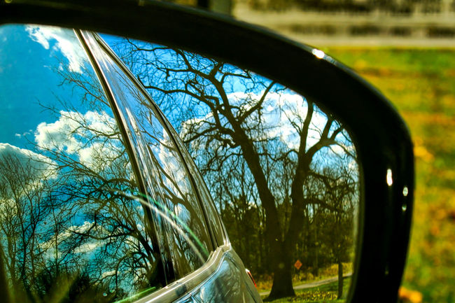 Rearview mirror triple reflection of rural scenery in Indiana. Waysofseeing Automobile Green Color Mirror Rearview Mirror Rural Trees Barren Landscape Blue Sky Car Close-up Clouds And Sky Day Fish-eye Lens Grass Landscape Nature No People Outdoors Reflections Side View Mirror Sky Tree Triple Vehicle Window Tree Plant Nature Glass - Material