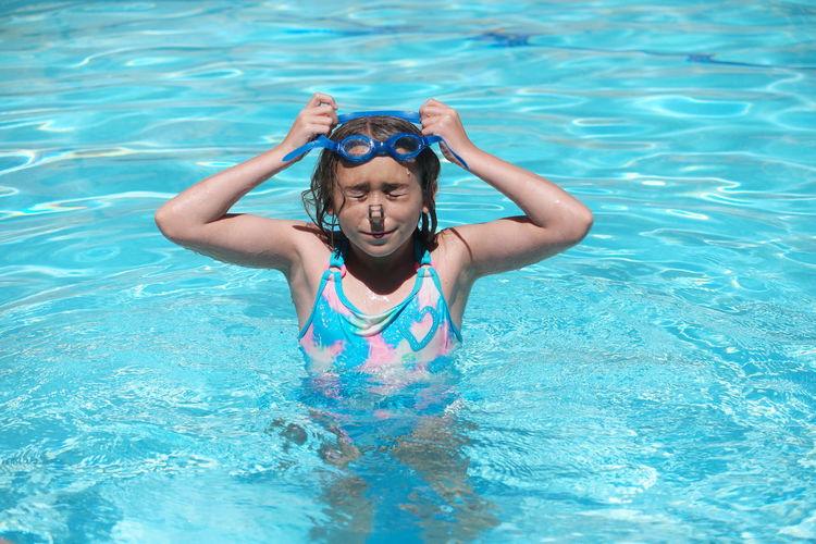 Girl Wearing Swimming Goggles In Pool