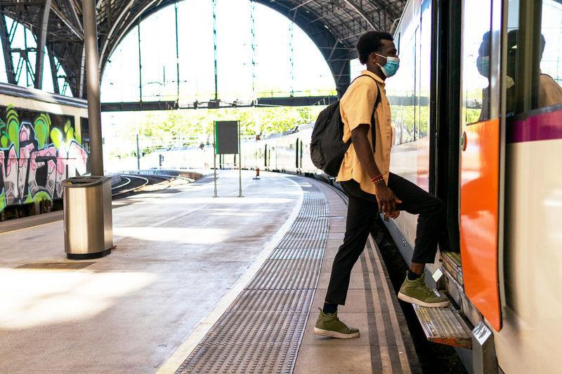 Man standing on railroad station platform