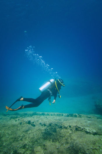 Scuba Diver Floating Underwater Underwater Scuba Diving Adventure Exploration Sea Wetsuit Marine Life Mediterranean  Activity Flippers Water Aquatic Sport UnderSea Nature Sea Life Extreme Sports underwater photography Woman Underwater Diving Diving Equipment Blue One Person Reef