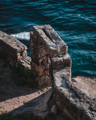 High angle view of old rock on sea shore