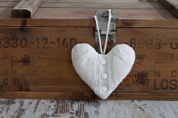 Knitted Heart Shape Hanging On Bed