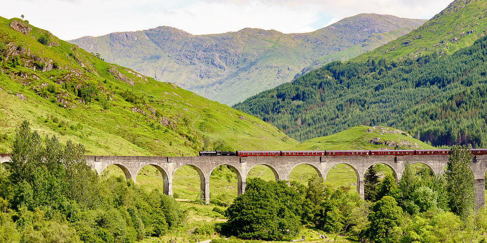Beauty In Nature Bridge - Man Made Structure Glenfinnan Landscape Mountain Nature Outdoors Train - Vehicle Viaduct