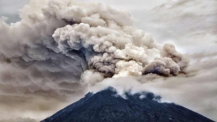 Eruption of Agung Volcano in Bali, Indonesia. The Photojournalist - 2018 EyeEm Awards Accidents And Disasters Active Volcano Ash Beauty In Nature Cloud - Sky Emitting Environment Erupting Geology Mountain Mountain Peak Natural Disaster Nature No People Ominous Pollution Power Power In Nature Sky Smoke - Physical Structure Volcanic Activity Volcanic Crater Volcano Warning Sign