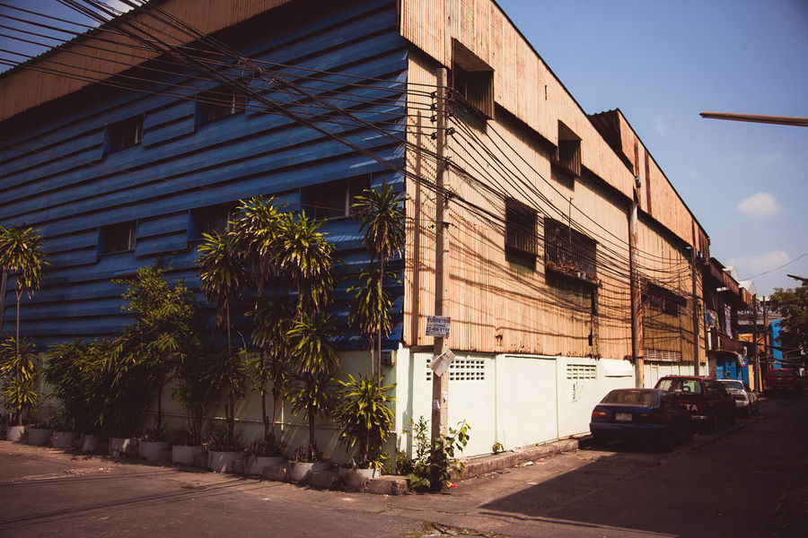 Architecture Building Exterior Built Structure Car City Day Factory Factory Building No People Outdoors Road Sky Street Tree