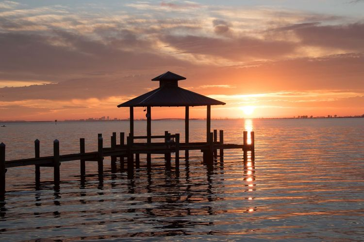 November sunrise Safety Harbor docks Cityscape Beauty In Nature Clouds And Sky Dock Orange Sunrise On The Ocean Reflective Water Surface Sea Tranquil Scene