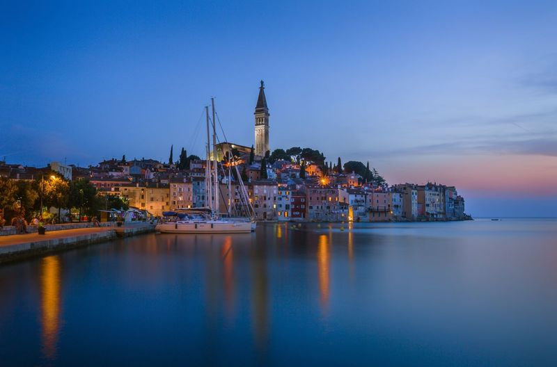 Horizon Over Water Sea Nautical Vessel Water Reflection Architecture Harbor Night Built Structure Building Exterior Sky Dusk Sunset Illuminated Transportation Moored Waterfront Sailboat Travel Destinations Cityscape Cloud - Sky Town Rovinj By Night