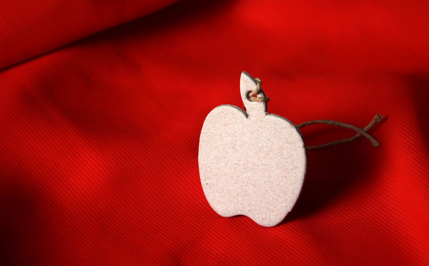 Apple Shape Decoration On Red Seat